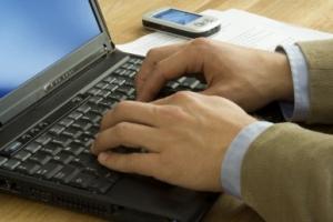 Business man Writing on Laptop