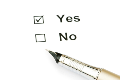 Pen and tick boxes with Yes and No options
