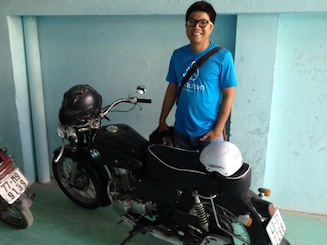 Loc, Founder of Aothun, with his 250cc BMW motorcycle