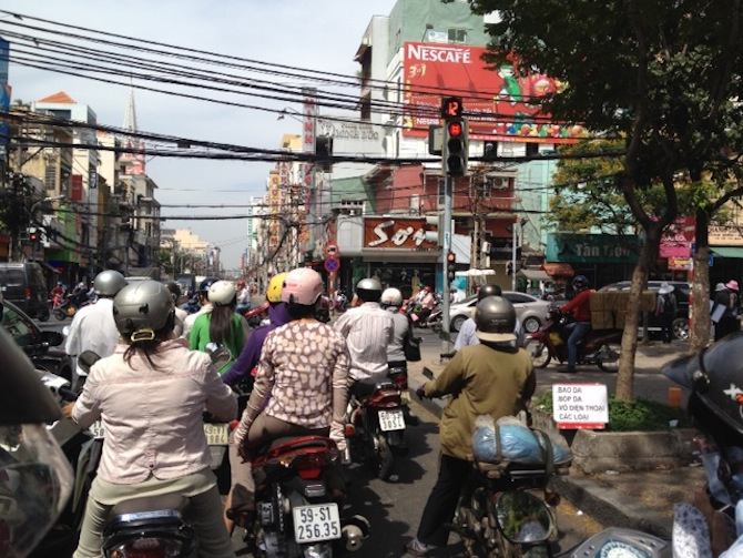 Zipping through the busy streets in Ho Chi Minh on Loc's motorcycle.