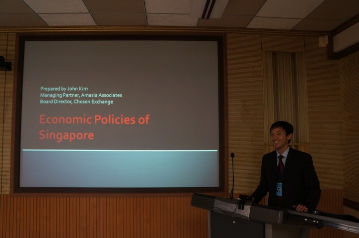 This is John Kim presenting about Singapore's economic policies.