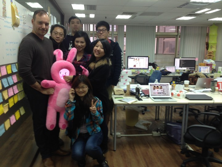 Jason Warren, left, holds TuTu with the Roam and Wander team at TMI in Taipei