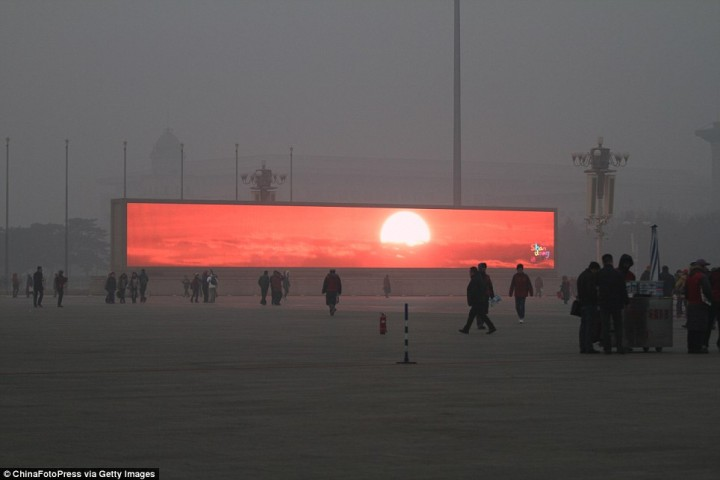 No, Beijing residents are NOT watching fake sunrises on giant TVs...