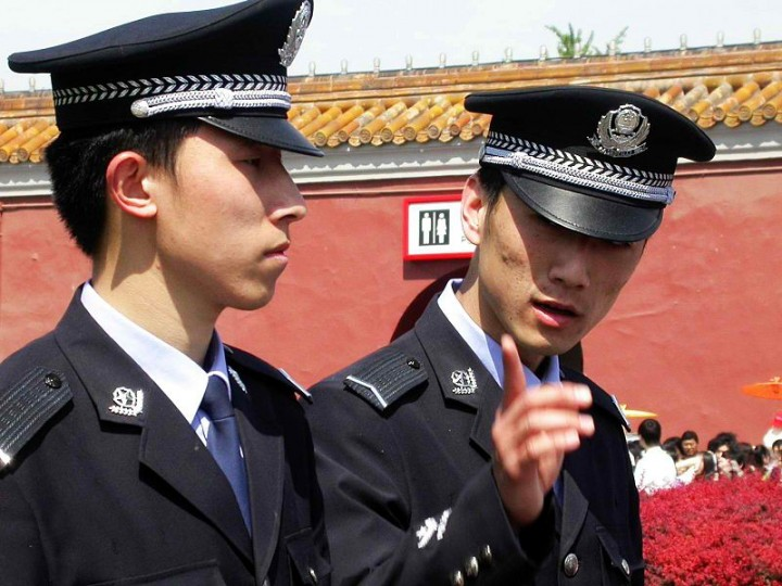 image Strong chinese police officers play with suit little master amp slave