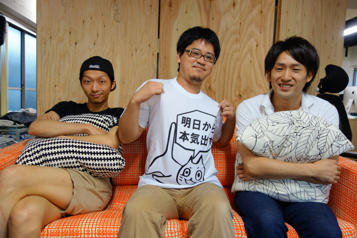 """From L-R, Taisuke Takemoto (head of business), Shinnosuke Ito (CEO), and  Masahiro Kawasaki (head of marketing). Ito's shirt says, """"Starting tomorrow, I'll try hard."""""""