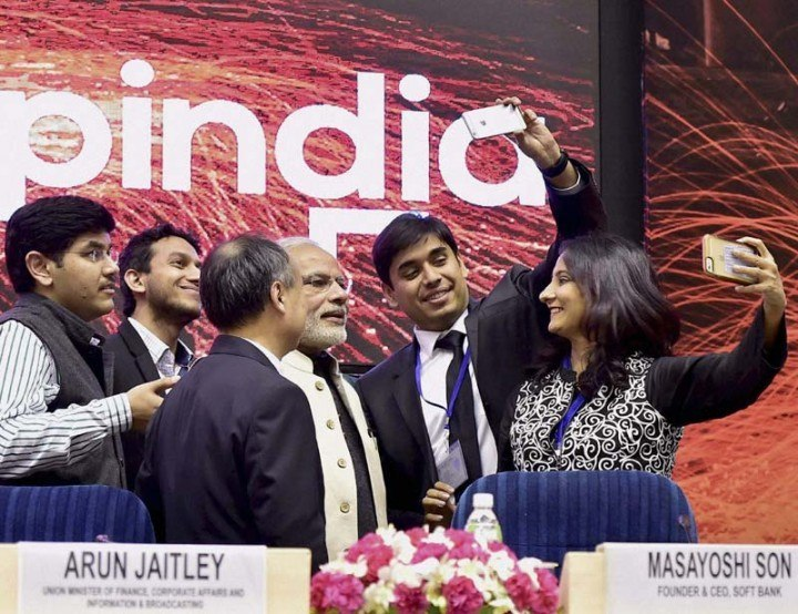 (Holding phones) MapMyGenome CEO Anu Acharya and InMobi CEO Naveen Tewari try to click a Selfie with Indian Prime Minister Narendra Modi at Startup India event in January, this year. Photo Credit: The Financial Express