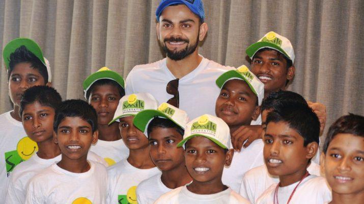 Virat Kohli with kids at Smile Foundation.
