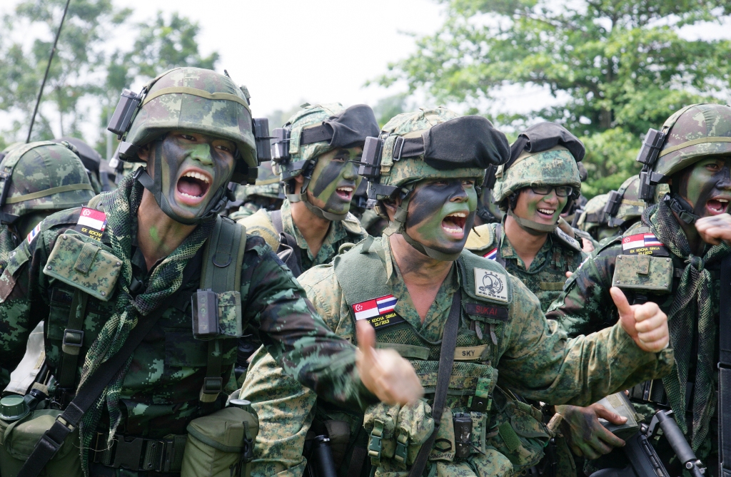 Troops from both the Singapore and Thailand armies doing a cheer during their training at the Murai Urban Training Facility. Photo credit: MINDEF