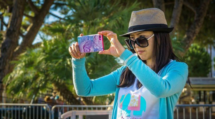 Girl taking picture on smartphone