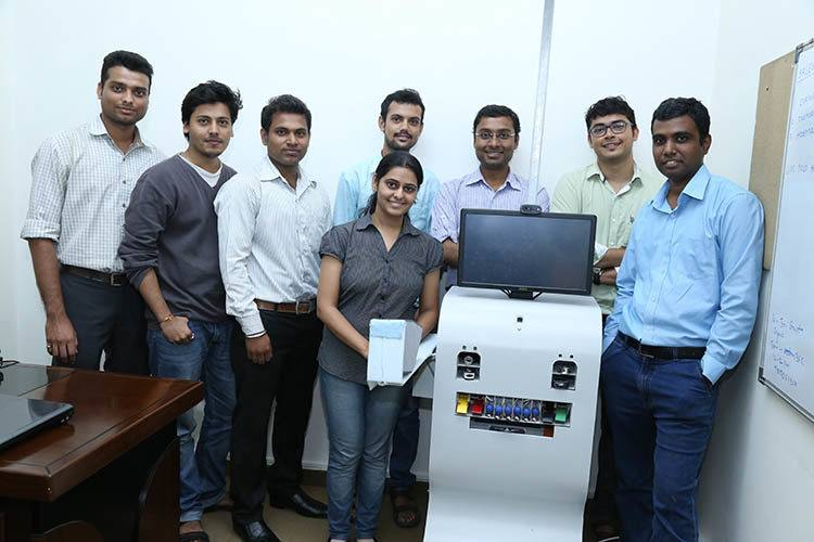 Yolo Health's team, along with one of their ATMs. Photo credit: YOLO Health.