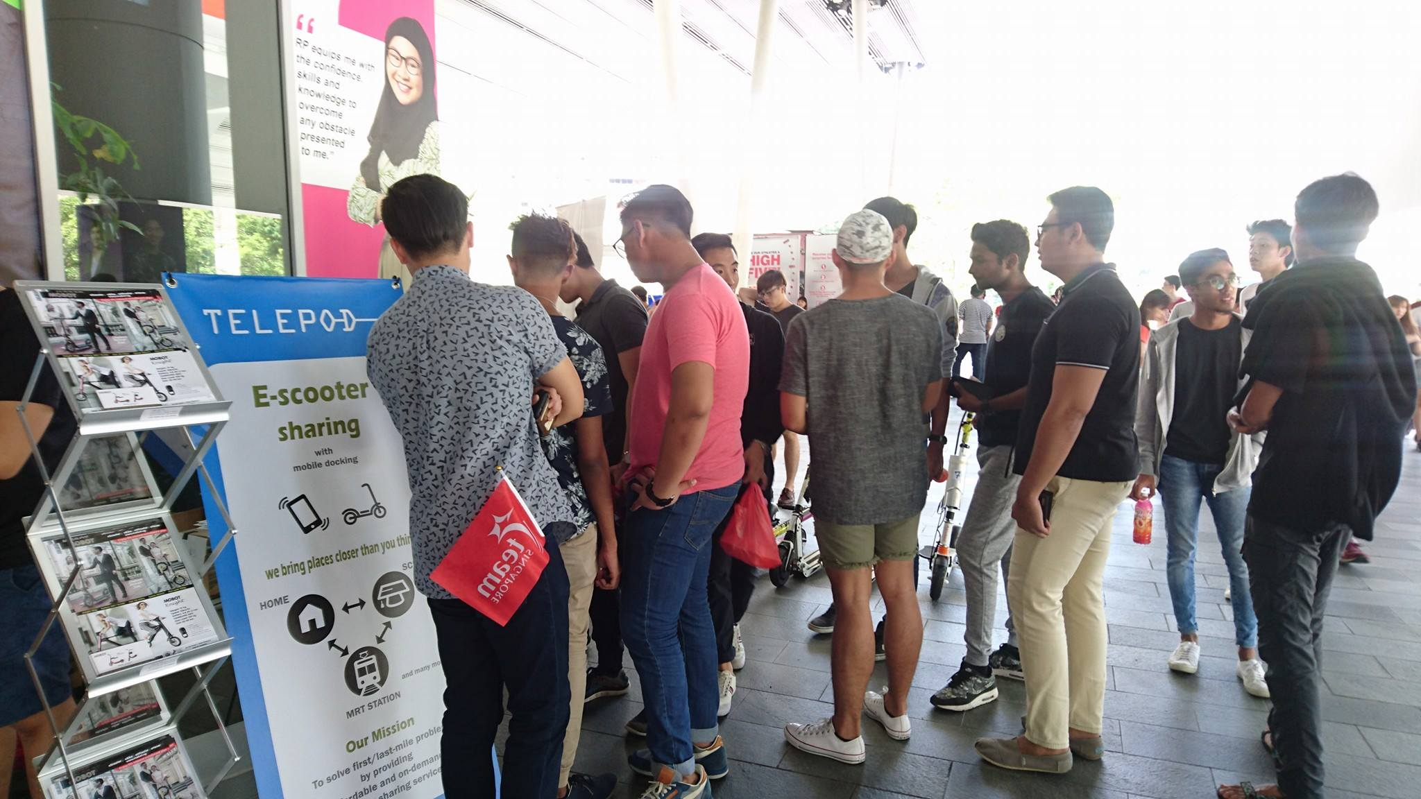 People queueing up at Woodlands MRT to rent e-scooters during Telepod's August trial run.