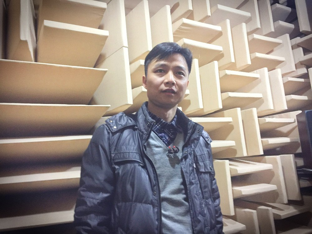 Inside FIIL's anechoic chamber with CTO Leon Wu at its R&D center. Photo credit: Tech in Asia.