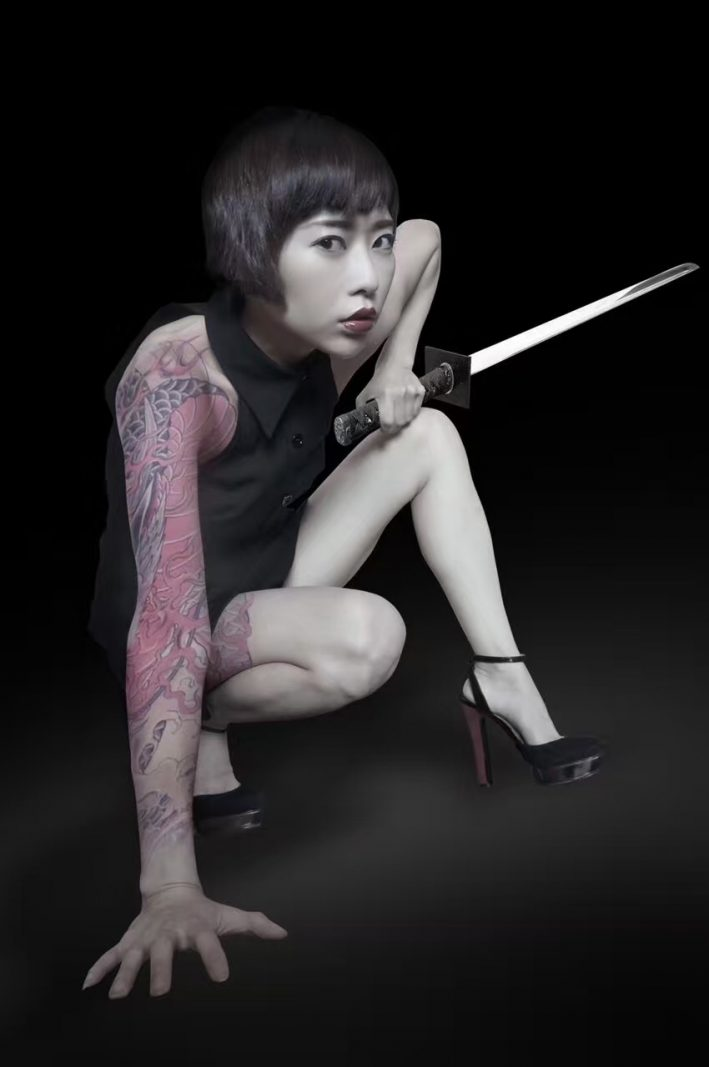 Yuanwu's husband loves photography and often helps her create content. He edited the tattoos and sword into this photo. Photo credit: Tan Yuanwu.