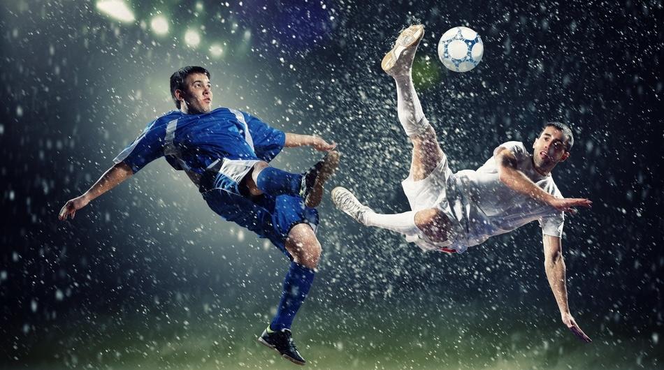 Football players in the rain