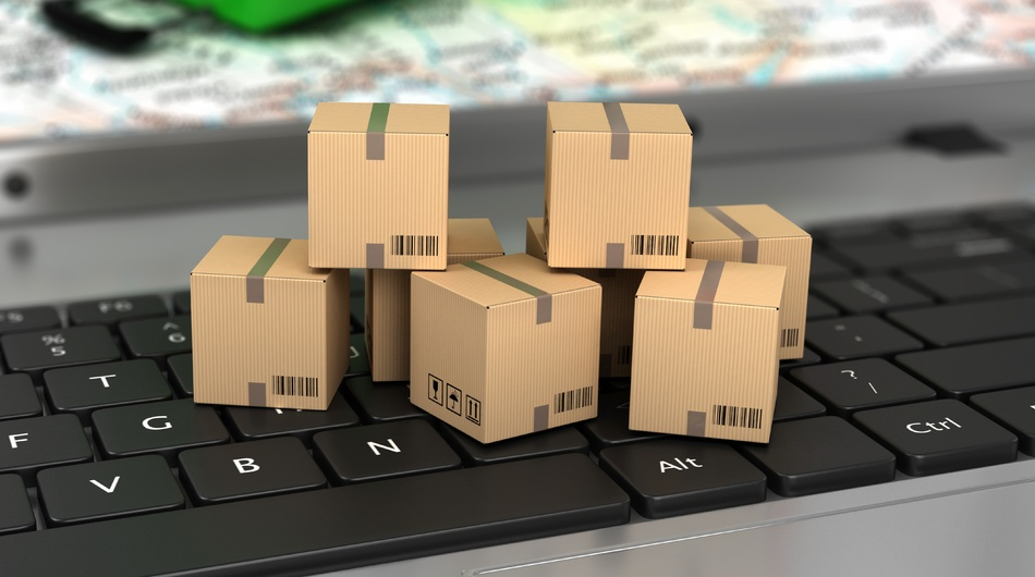 Ecommerce logistics and delivery, boxes on keyboard