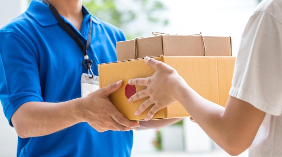 Courier delivering parcels, last-mile delivery, logistics