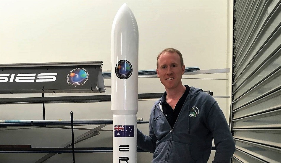 Gilmour Space CEO Adam Gilmour with the Eris rocket