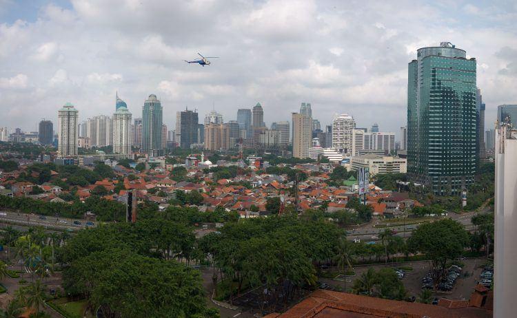 Helicopter flying over Jakarta.