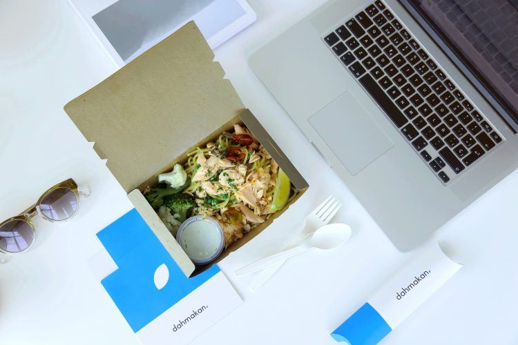 Dahmakan delivery box on desk.