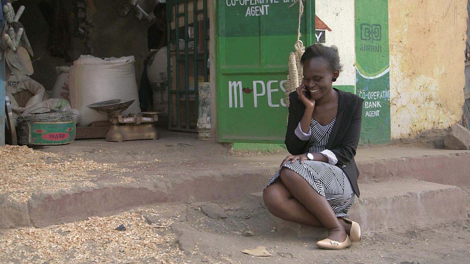 mobile money, Kenya, woman on phone