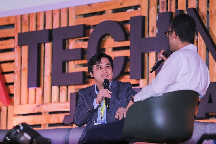 99.co CEO Darius Cheung on stage at Tech in Asia Jakarta 2017